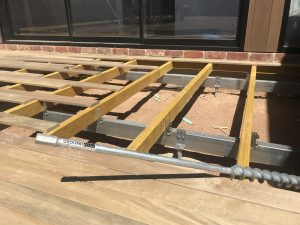 Engineered screw pile footings for decks